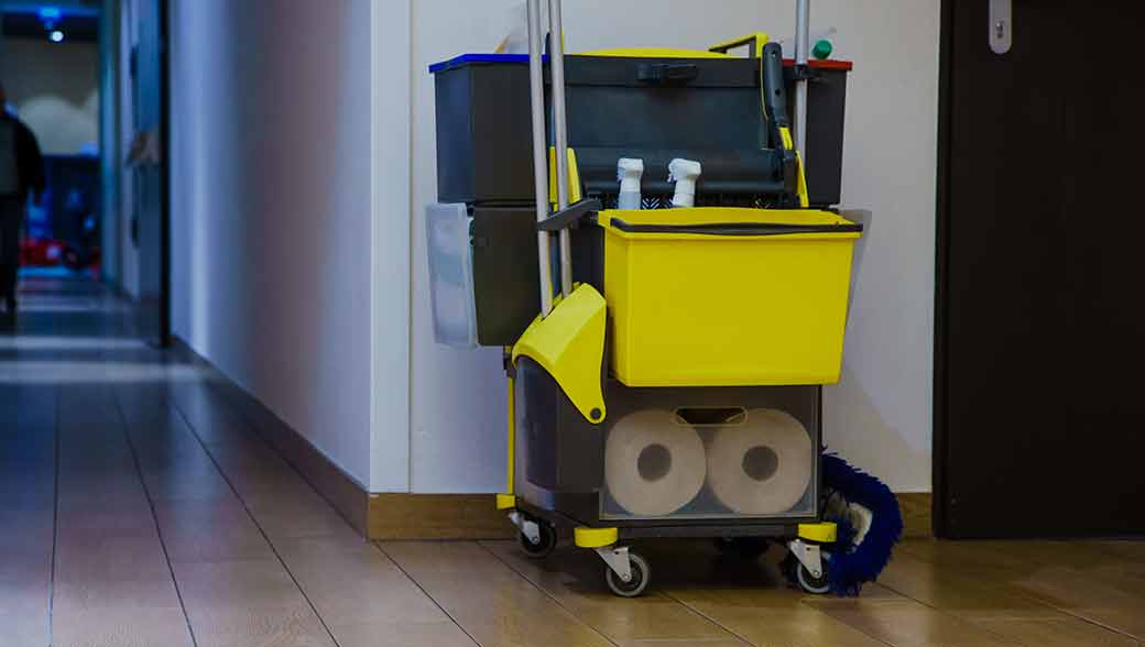 Janitorial cart with supplies and equipment